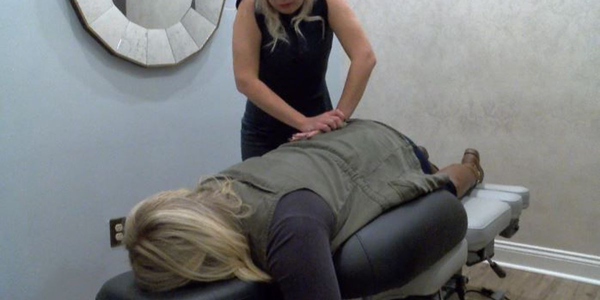 Chiropractors adjusting women who are expecting