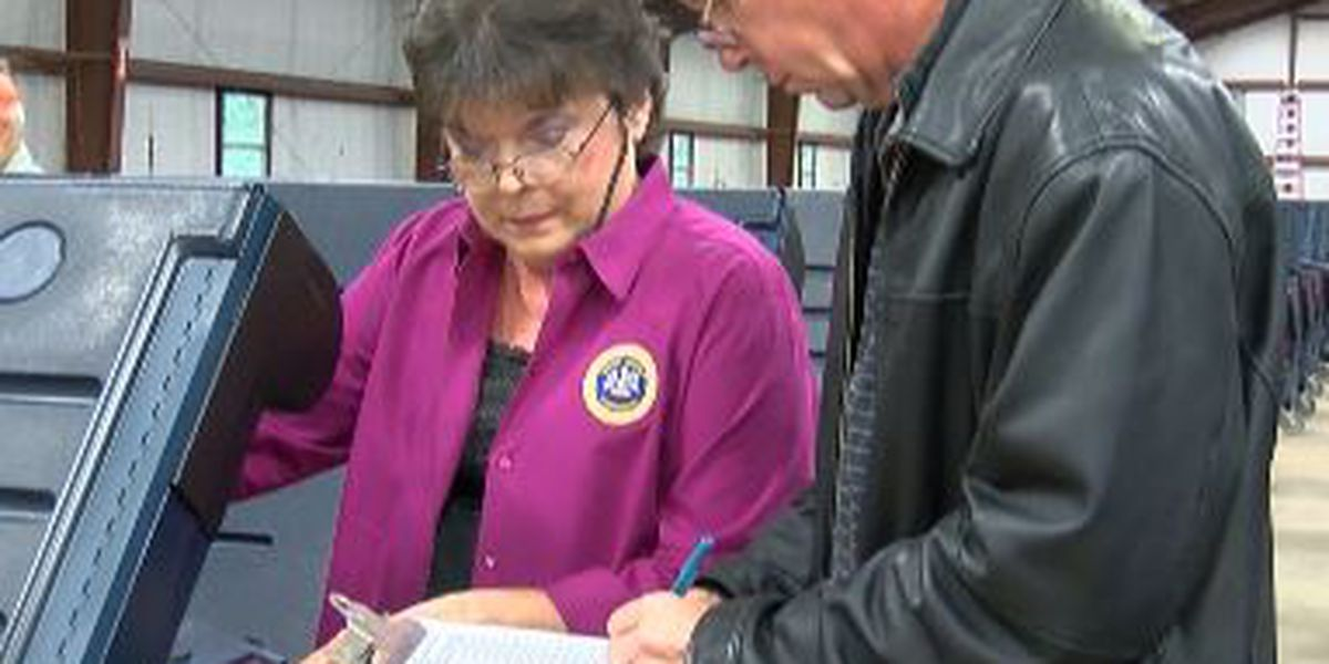 Election officials open voting machines to verify Tuesday results
