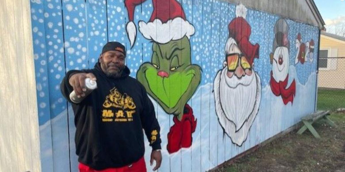 Artist spreads holiday cheer with garage mural of Santa, the Grinch