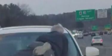 Armed man stops road rage incident when he sees man clinging to hood of SUV