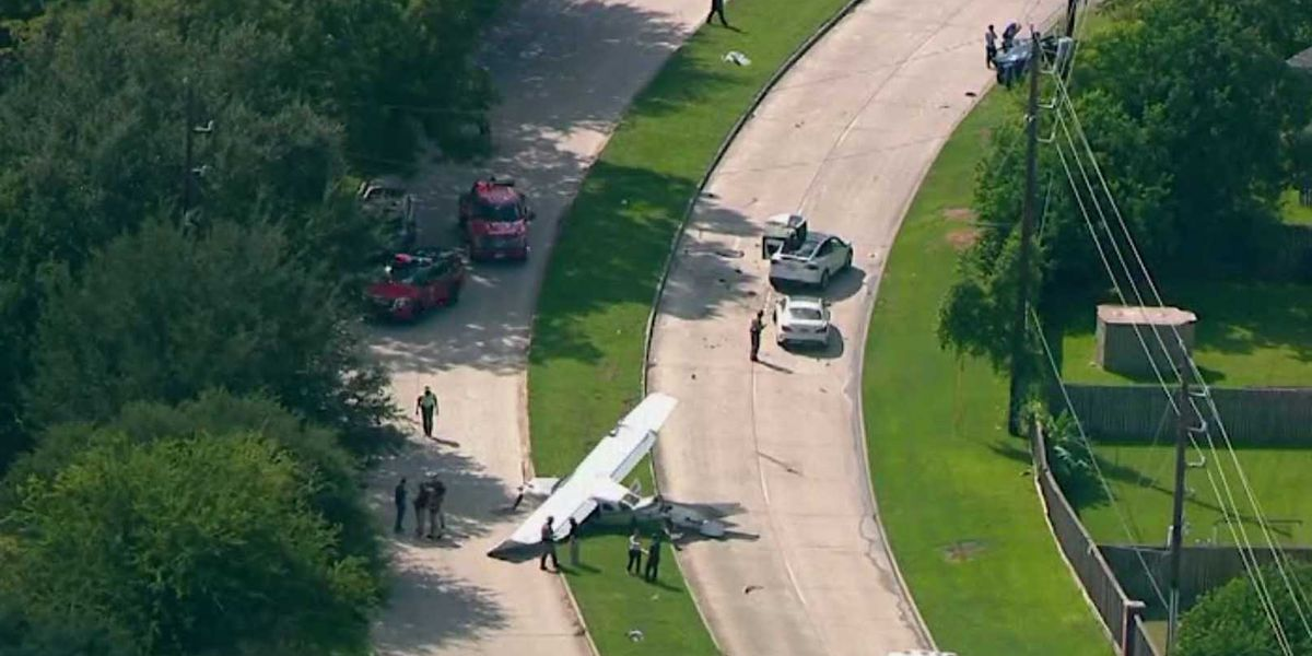 Plane crashes into several cars in Texas neighborhood