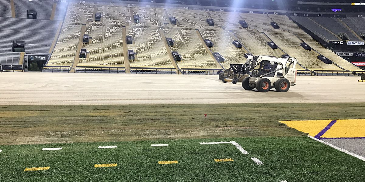 Crews lay new field inside Tiger Stadium, including artificial turf in non-playing areas