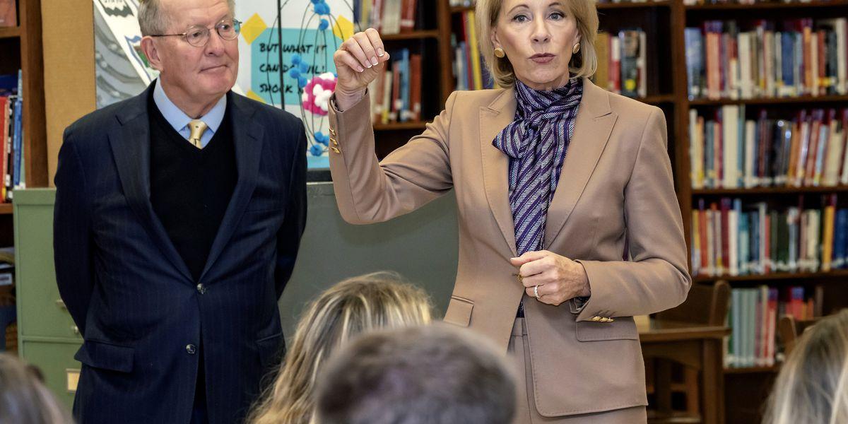DeVos warns of crisis amid ballooning student debt