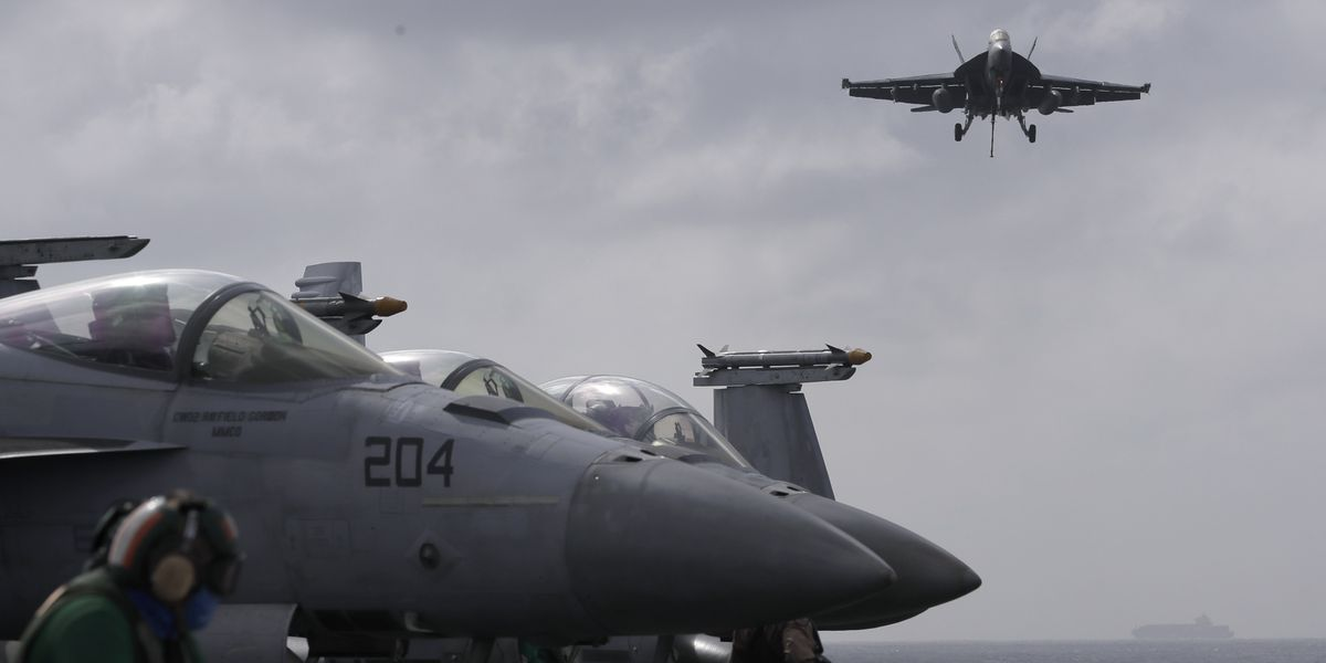 US carrier in Hong Kong after bombers fly over S. China Sea
