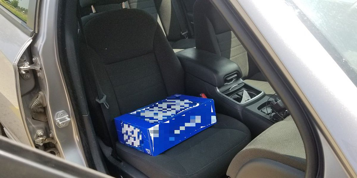 Driver accused of using 30-can beer pack as booster seat for 2-year-old