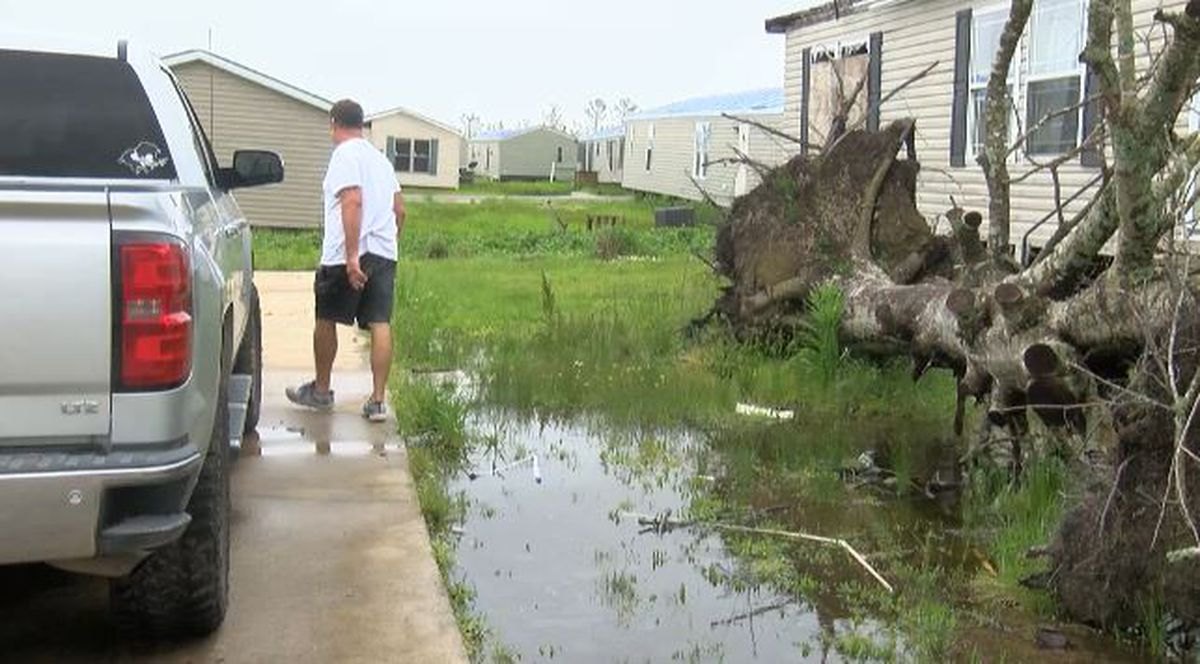 Rain and pockets of water slow hurricane recovery