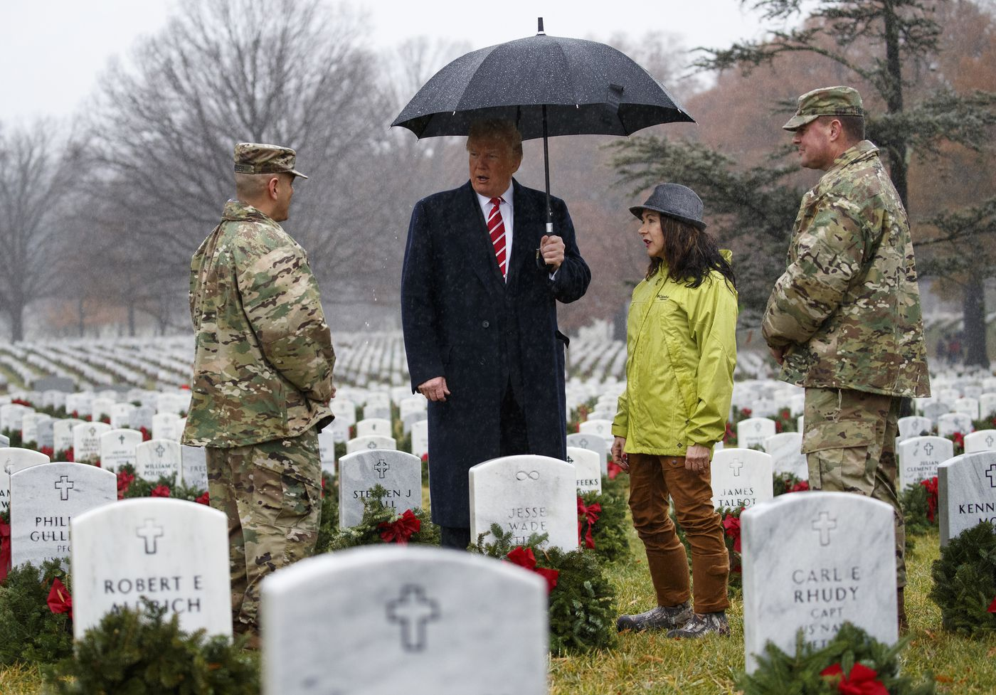 President Donald Trump pauses and talks as he visits Section 60 at Arlington National Cemetery in Arlington, Va., Saturday, Dec. 15, 2018, during Wreaths Across America Day. Wreaths Across America was started in 1992 at Arlington National Cemetery by Maine businessman Morrill Worcester and has expanded to hundreds of veterans' cemeteries and other locations in all 50 states and beyond. (AP Photo/Carolyn Kaster)