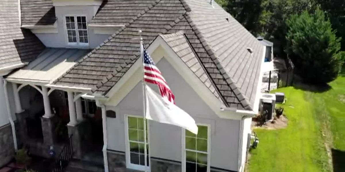 Grieving family in dispute with homeowners association over flagpole