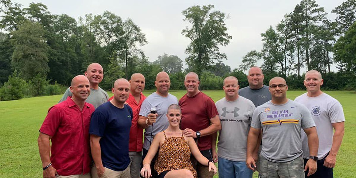 Deputies shave their heads to support colleague's wife during cancer battle