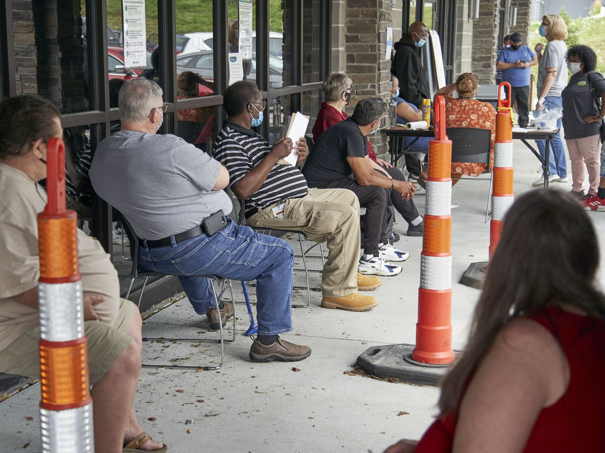 Jobless claims fall to 751,000, but new infections a threat