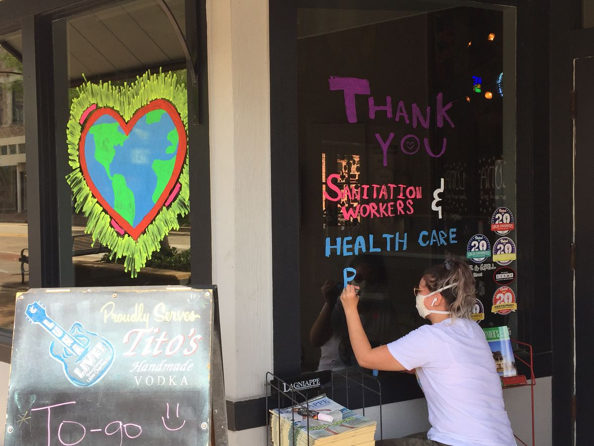 Local artist creates window art to show thanks