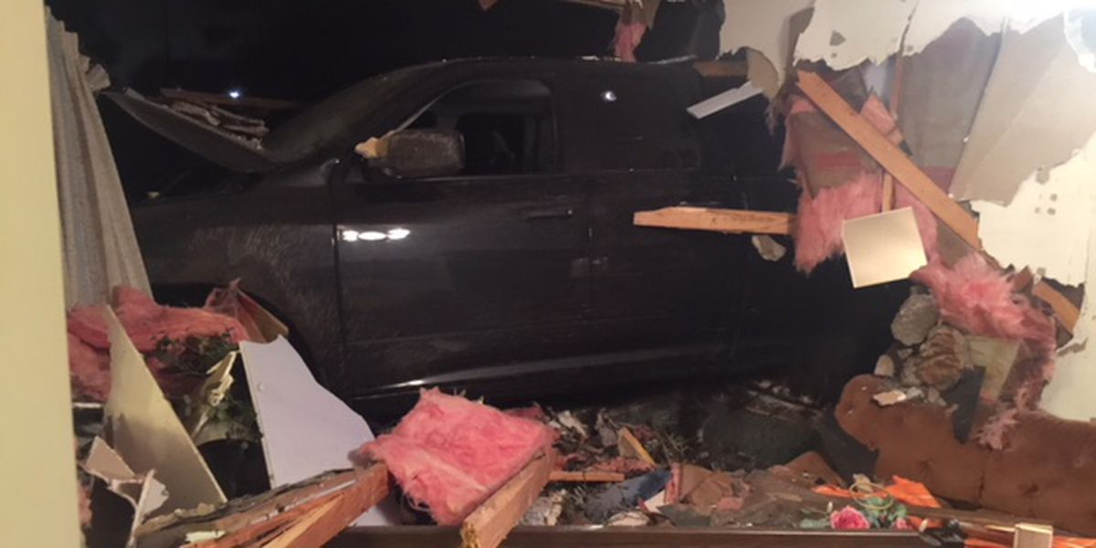 CPSO: one in custody after truck crashes into house
