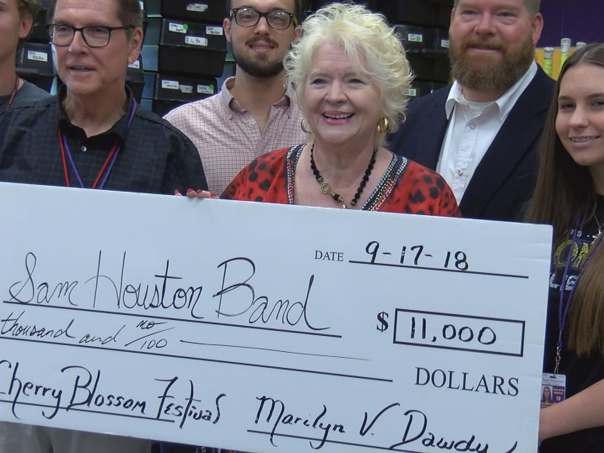 Service with a smile: Sam Houston band receives donation to attend national festival
