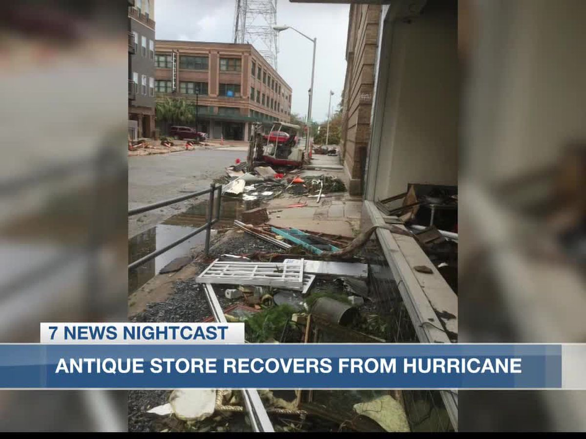Hurricanes bust windows and cause flooding of antique shop, leaving merchandise in the street