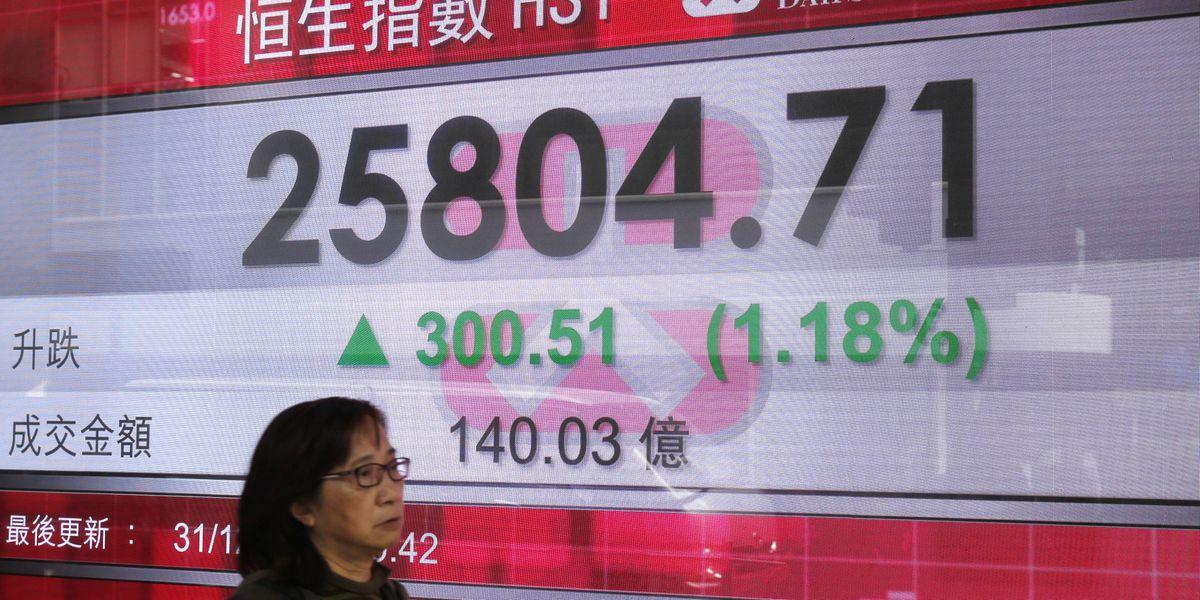 World stocks rise on last day of turbulent year